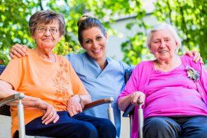 Geriatric nurse having chat with senior women